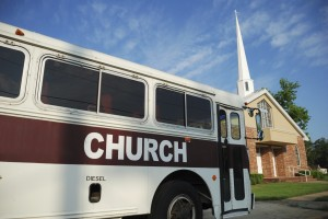 Church bus, car, van in front of church - church car insurance