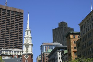 A church among city buildings - church property and building insurance