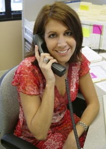 Church volunteer answering phone - represents need for volunteer and employment practices liability insurance